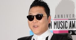 PSY arrives at the American Music Awards