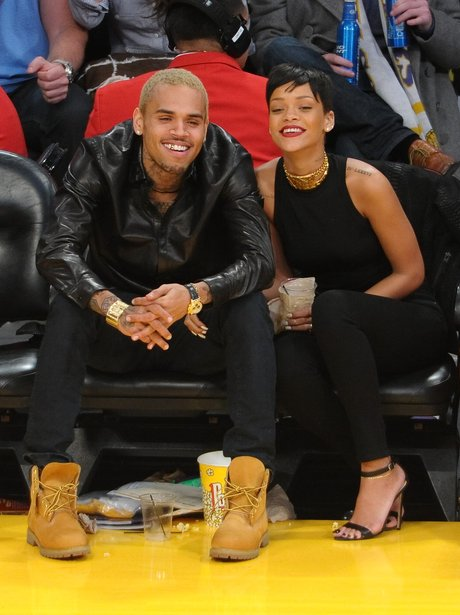 Rihanna and Chris Brown watching basketball together