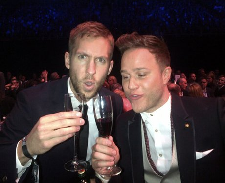 Calvin Harris and Olly Murs drinking champagne