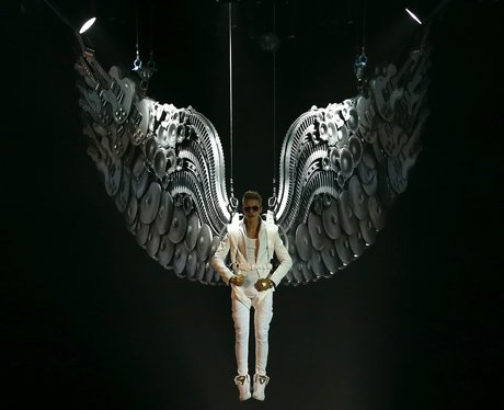 Justin Bieber drops in from the arena ceiling on his 'Believe' tour