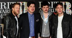 Marcus Mumford (second left), Winston Marshall (se