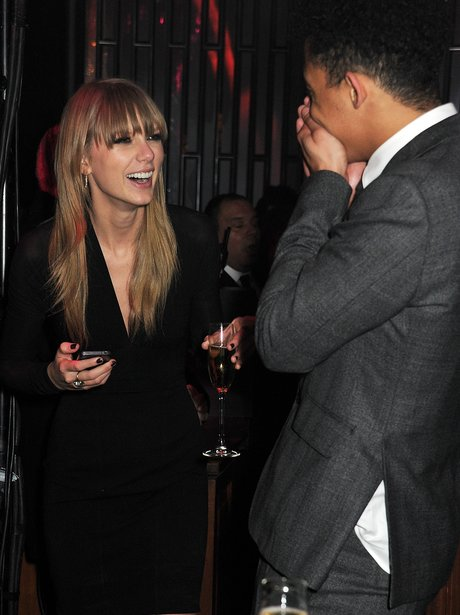 Taylor Swift exchanging numbers with Jordan from Rizzle Kicks