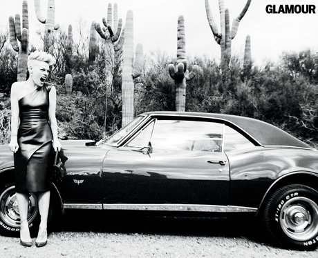 Pink standing next to a classic car