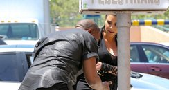 Kanye West hits head on sign post