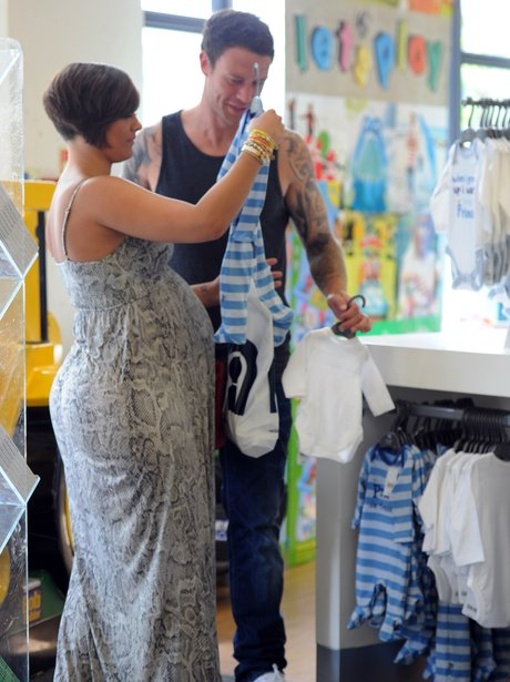 Frankie Sandford shopping for baby clothes with Wayne Bridge