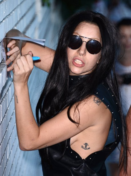 Lady Gaga signing autographs outside Chateau Marmont