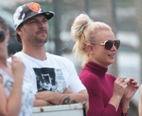 Britney Spears and Kevin Federline watching football