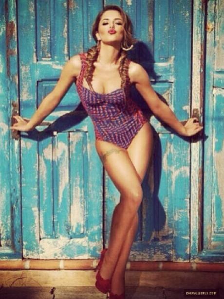 Cheryl Cole in a purple bathing suit