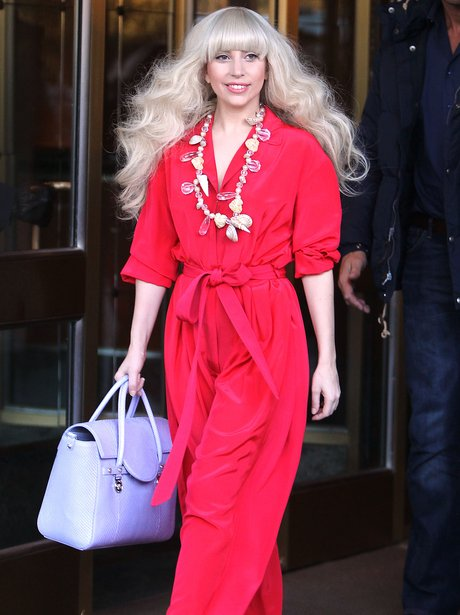 Lady Gaga wearing a red playsuit