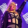 Ellie Goulding wearing a bodysuit on stage