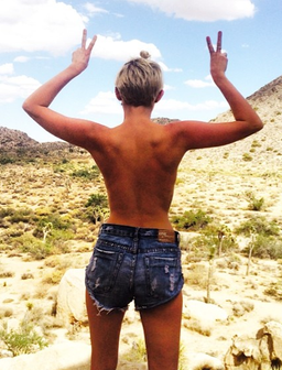 Miley Cyrus topless with denim shorts