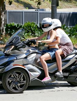 Miley Cyrus and Noah riding a motorbike