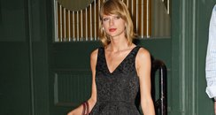 Taylor Swift wearing a black dress