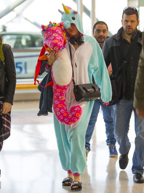Miley Cyrus wearing a unicorn onesie