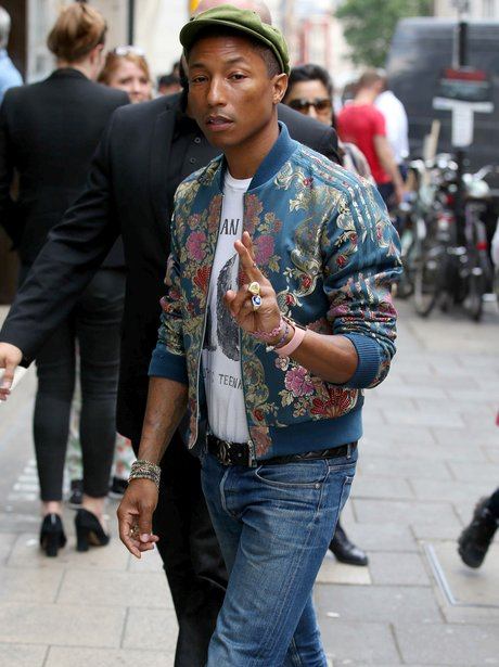 Pharrell wearing a bomber jacket