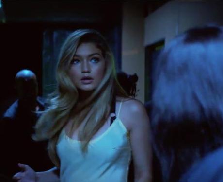 Gigi Hadid walking down corridor