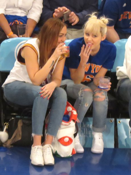 Miley Cyrus takes her sister to the basketball